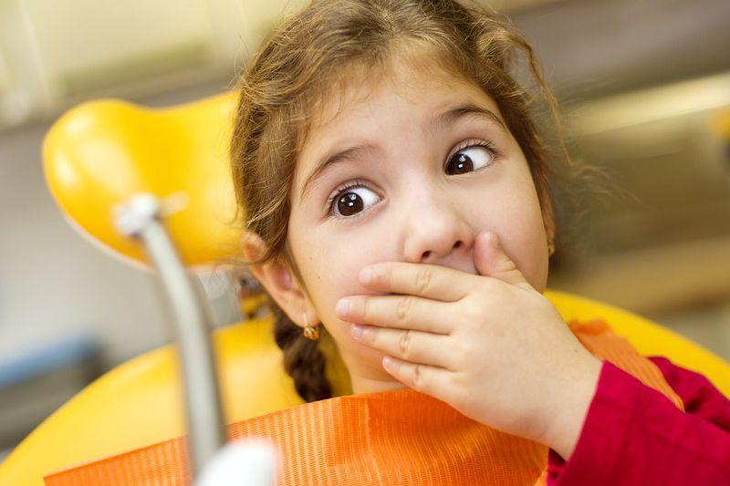 Criança com medo de dentista
